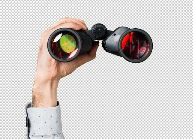 Hand of man holding with binoculars Premium Psd