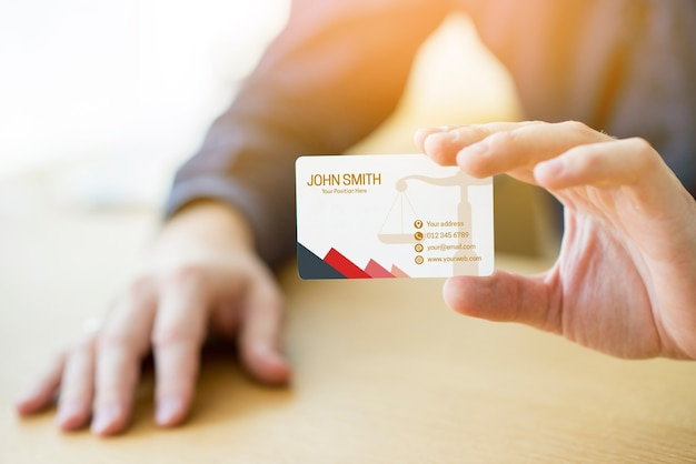 Hand presenting business card mockup Free Psd