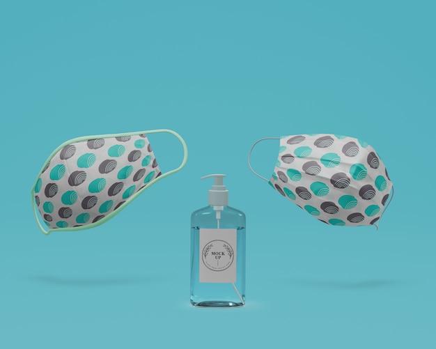 Ручные маски для лица и дезинфицирующее средство для рук с макетом Бесплатные Psd