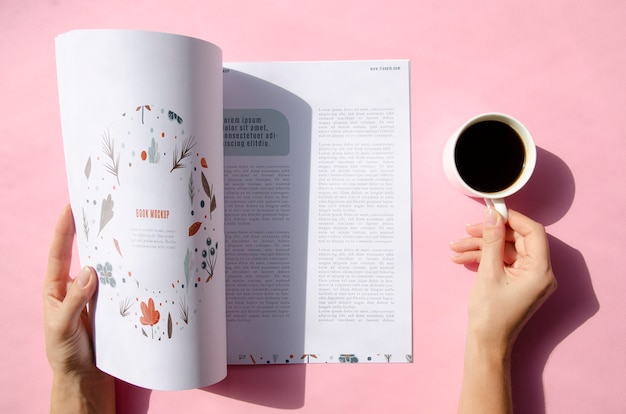 Hands holding a magazine and a cup of coffee mock up Free Psd