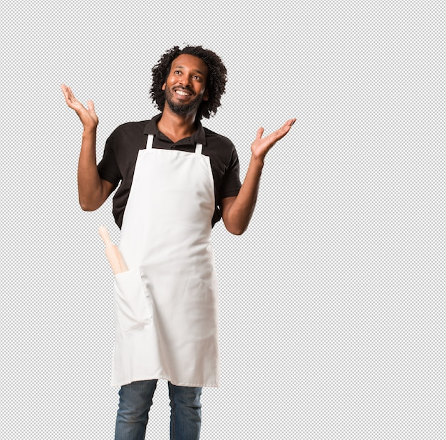 Handsome african american baker laughing and having fun, being relaxed and cheerful, feels confident and successful Premium Psd