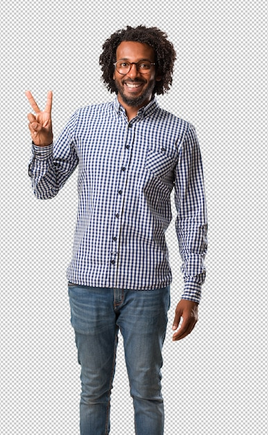 Handsome business african american man fun and happy, positive and natural, makes a gesture of victory, peace concept Premium Psd