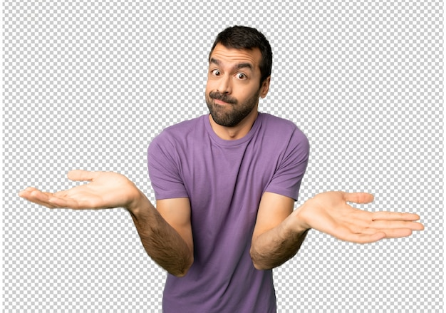 Handsome man having doubts while raising hands and shoulders Premium Psd
