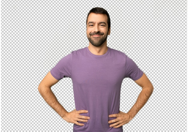 Handsome man posing with arms at hip and laughing looking to the front Premium Psd