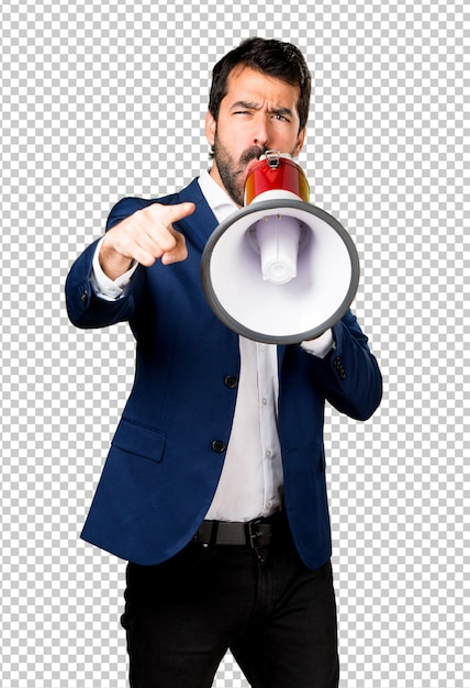 Handsome man shouting by megaphone Premium Psd