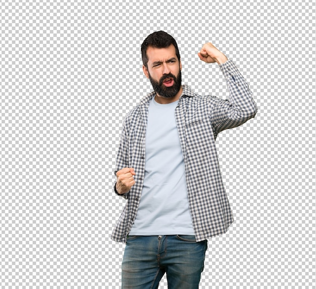 Handsome man with beard celebrating a victory Premium Psd