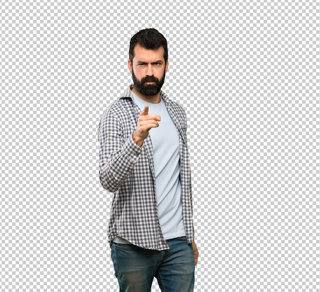 Handsome man with beard frustrated and pointing to the front Premium Psd