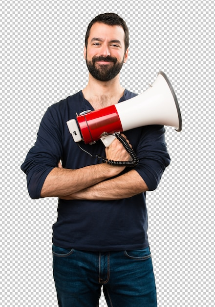 Handsome man with beard holding a megaphone Premium Psd