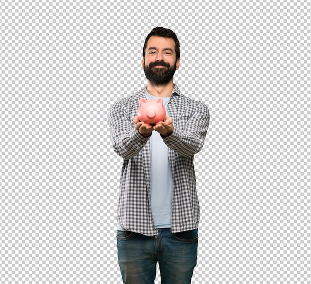 Handsome man with beard holding a piggybank Premium Psd