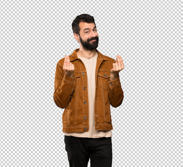 Handsome man with beard making money gesture Premium Psd