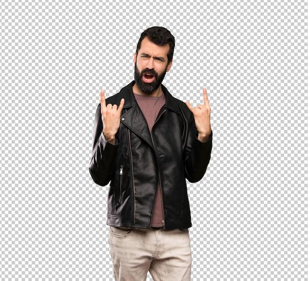 Handsome man with beard making rock gesture Premium Psd
