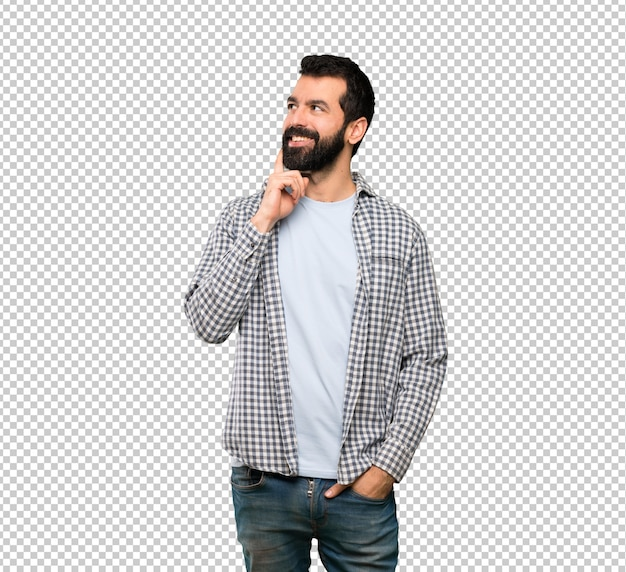 Handsome man with beard thinking an idea while looking up Premium Psd