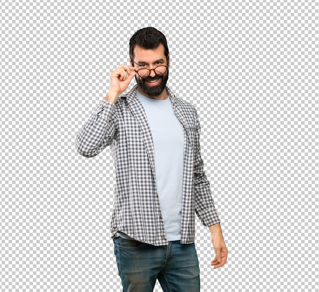 Handsome man with beard with glasses and surprised Premium Psd