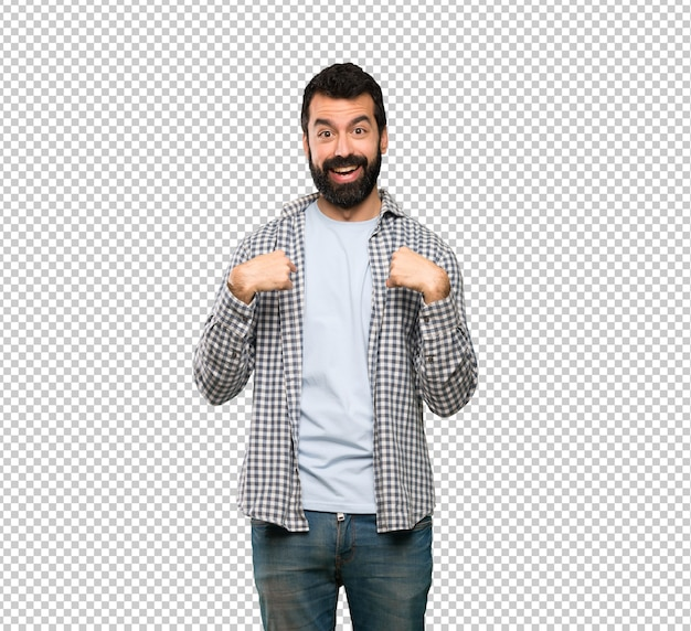 Handsome man with beard with surprise facial expression Premium Psd