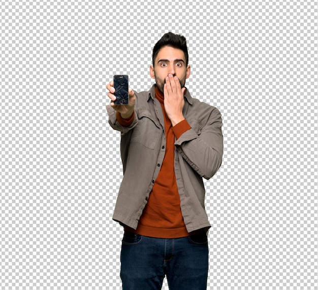Handsome man with beard with troubled holding broken smartphone Premium Psd