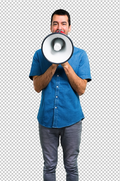 Handsome man with blue shirt holding a megaphone Premium Psd