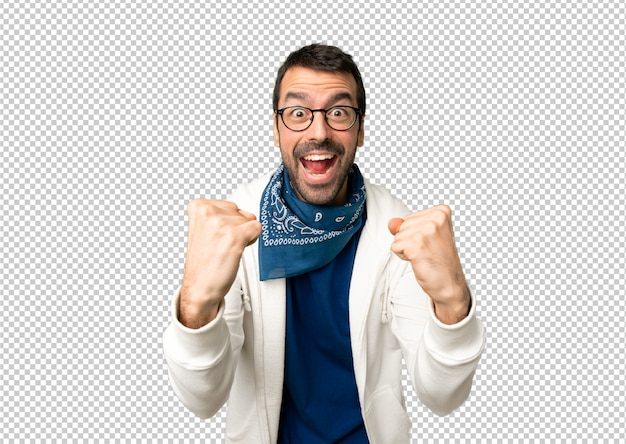 Handsome man with glasses celebrating a victory in winner position Premium Psd
