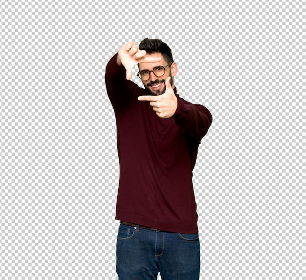Handsome man with glasses focusing face. framing symbol Premium Psd