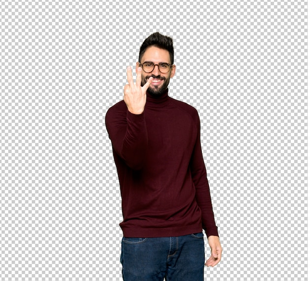 Handsome man with glasses happy and counting three with fingers Premium Psd