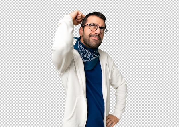 Handsome man with glasses having doubts while scratching head Premium Psd