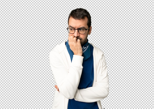 Handsome man with glasses having doubts Premium Psd