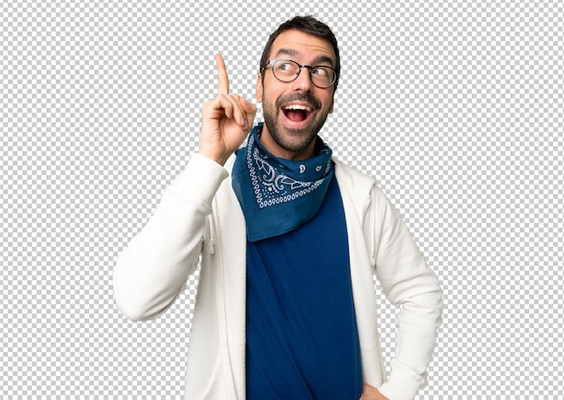 Handsome man with glasses intending to realizes the solution while lifting a finger up Premium Psd