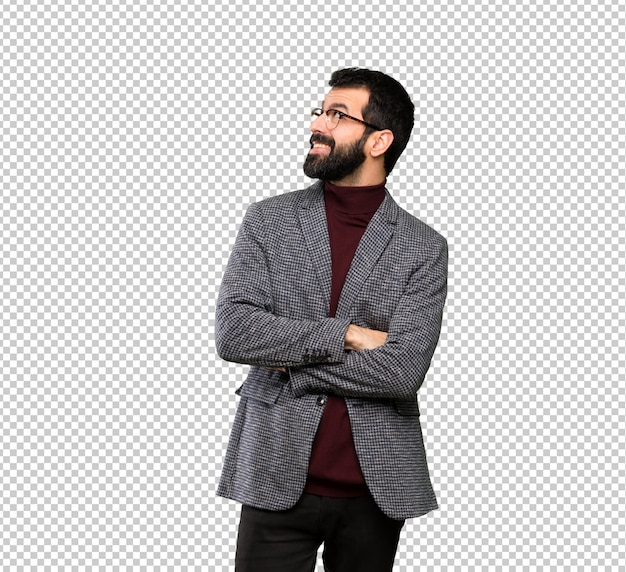 Handsome man with glasses looking up while smiling Premium Psd