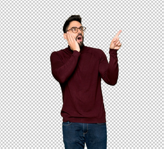 Handsome man with glasses pointing up and surprised Premium Psd