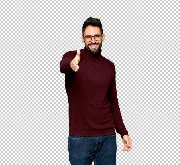 Handsome man with glasses shaking hands for closing a good deal Premium Psd
