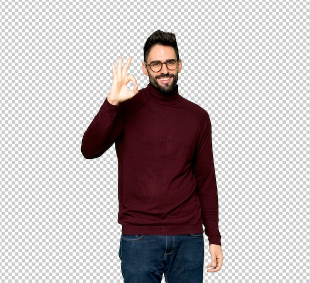 Handsome man with glasses showing an ok sign with fingers Premium Psd