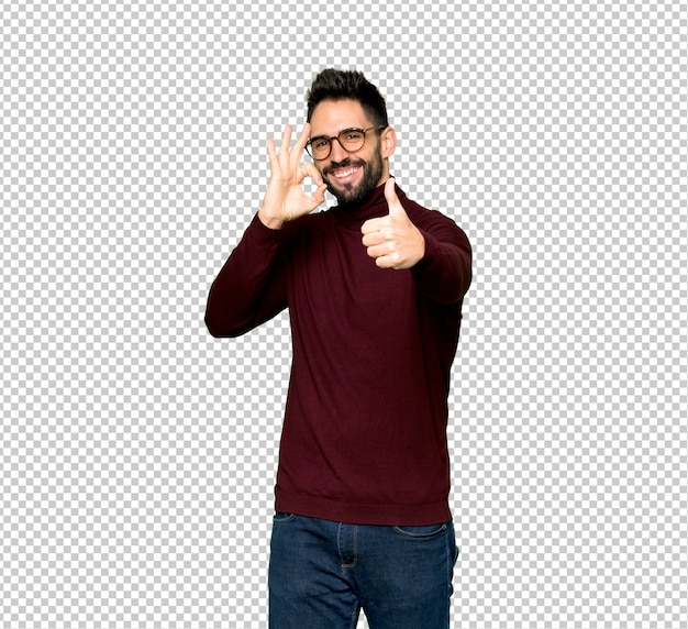 Handsome man with glasses showing ok sign with and giving a thumb up gesture Premium Psd