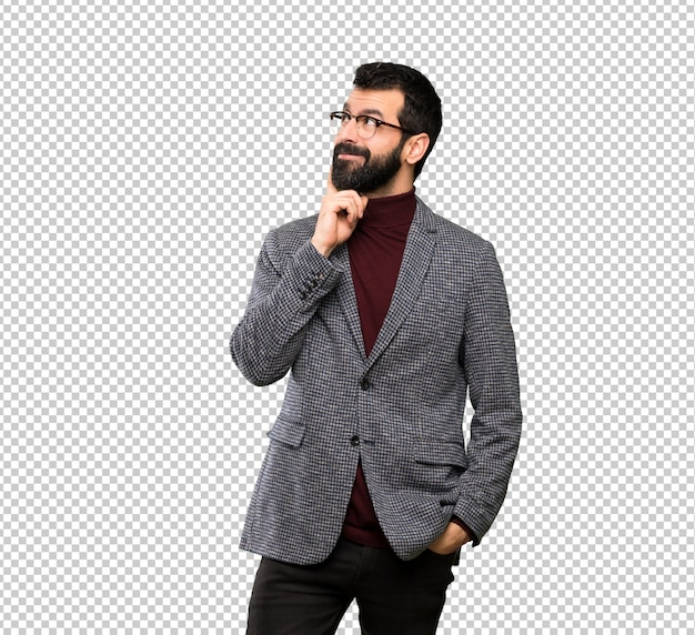 Handsome man with glasses thinking an idea while looking up Premium Psd