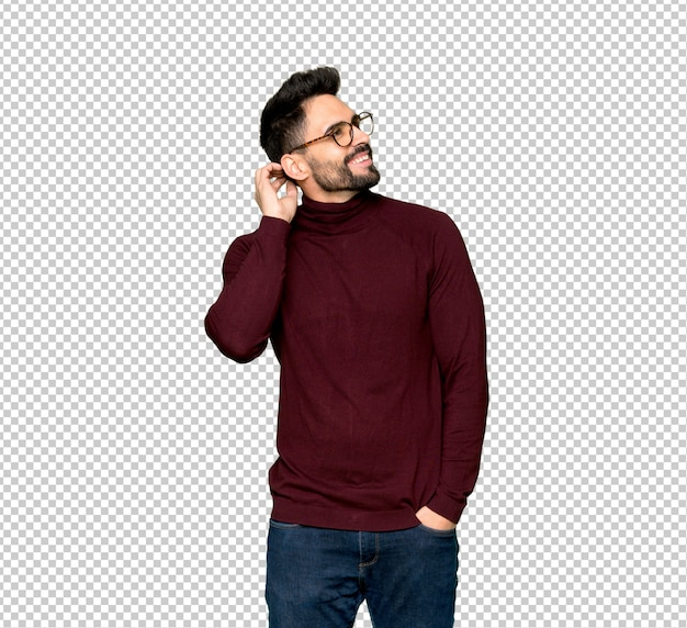 Handsome man with glasses thinking an idea while scratching head Premium Psd