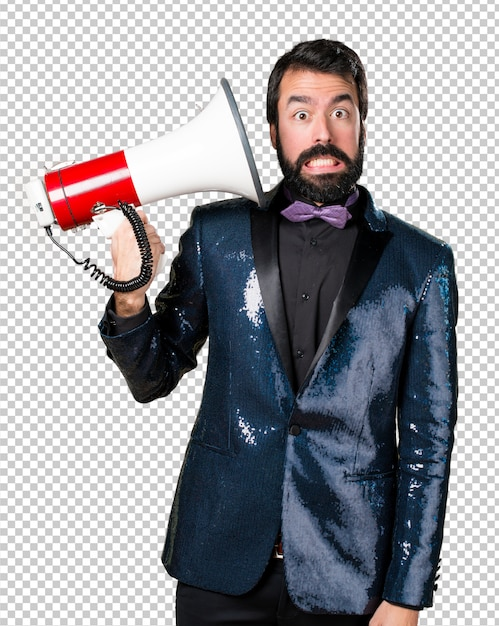 Handsome man with sequin jacket shouting by megaphone Premium Psd