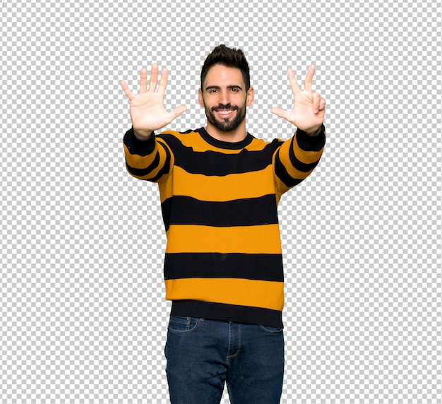 Handsome man with striped sweater counting eight with fingers Premium Psd