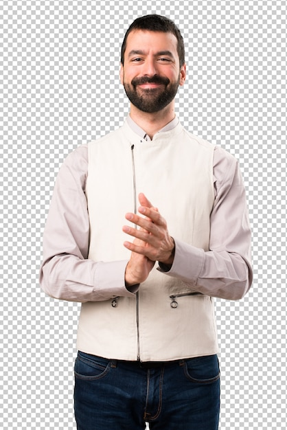 Handsome man with vest applauding Premium Psd