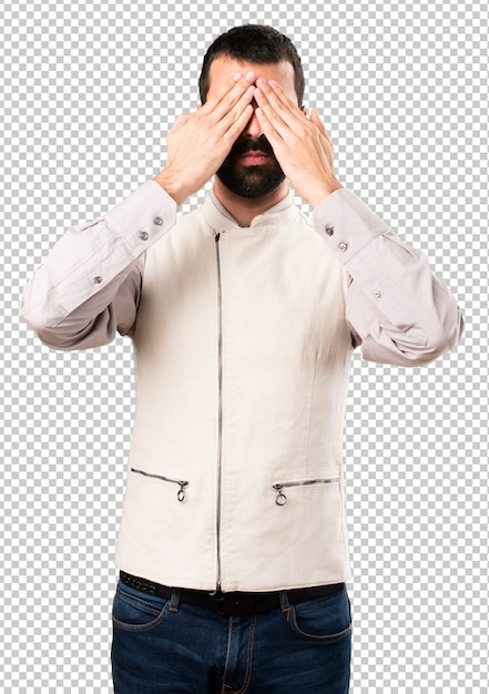 Handsome man with vest covering his eyes Premium Psd