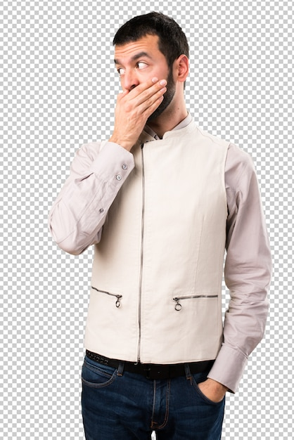 Handsome man with vest covering his mouth Premium Psd