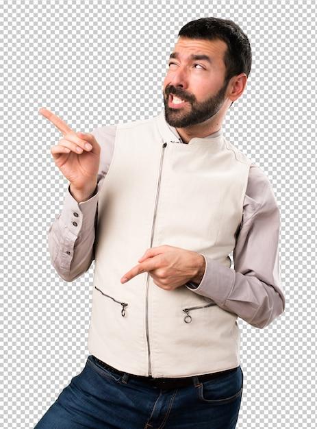 Handsome man with vest dancing Premium Psd