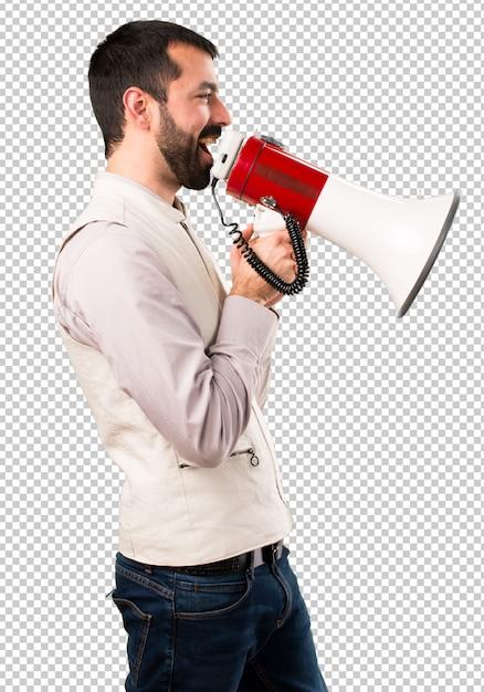 Handsome man with vest holding a megaphone Premium Psd