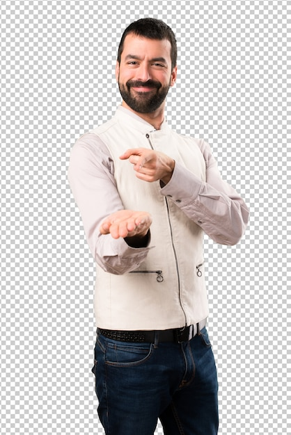 Handsome man with vest holding something Premium Psd