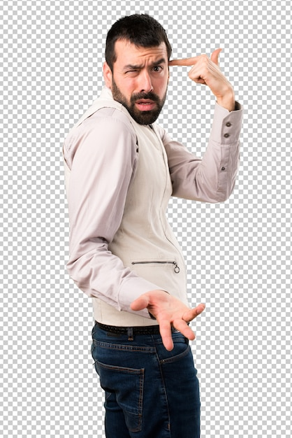 Handsome man with vest making crazy gesture Premium Psd