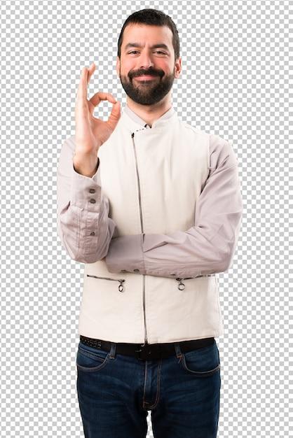 Handsome man with vest making ok sign Premium Psd