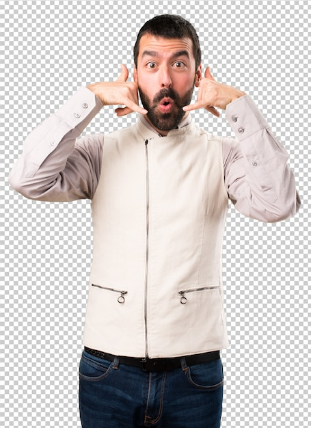 Handsome man with vest making phone gesture Premium Psd