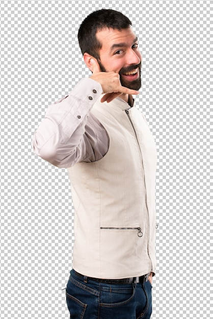 Handsome man with vest making phone gesture Premium Psd