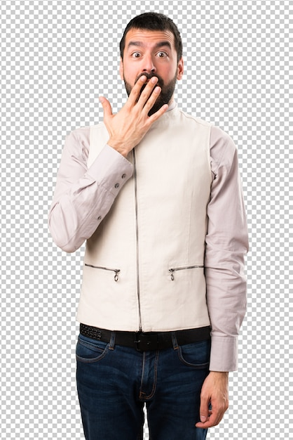 Handsome man with vest making surprise gesture Premium Psd