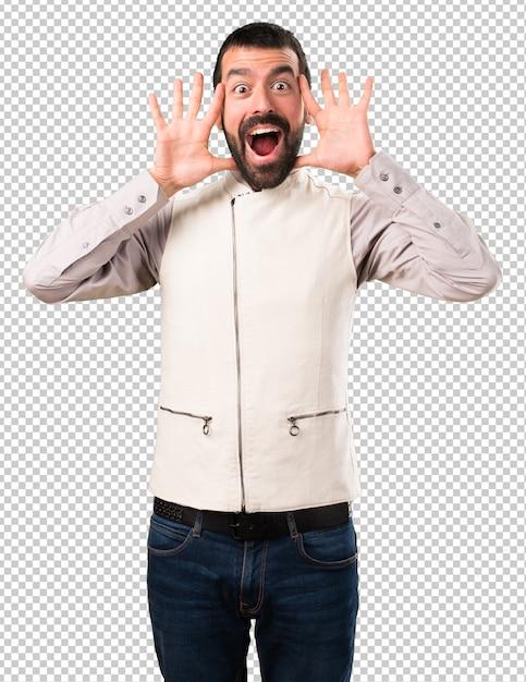 Handsome man with vest making surprise gesture Premium Psd