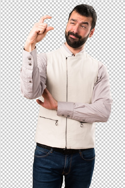 Handsome man with vest making tiny sign Premium Psd