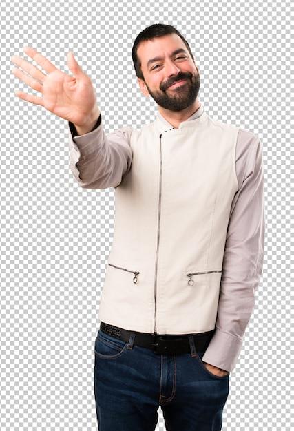 Handsome man with vest saluting Premium Psd