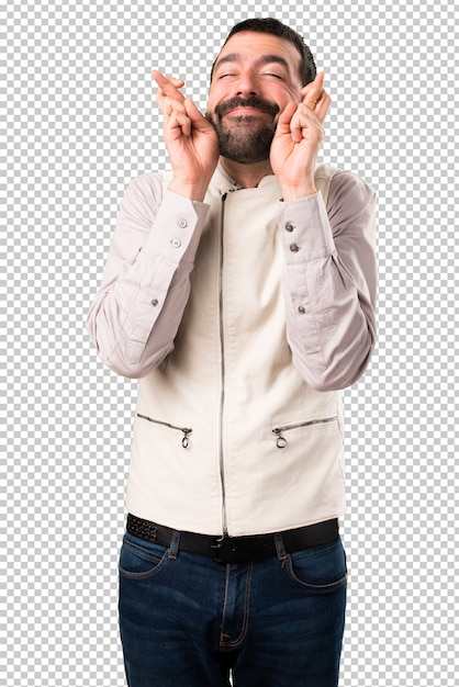 Handsome man with vest with his fingers crossing Premium Psd